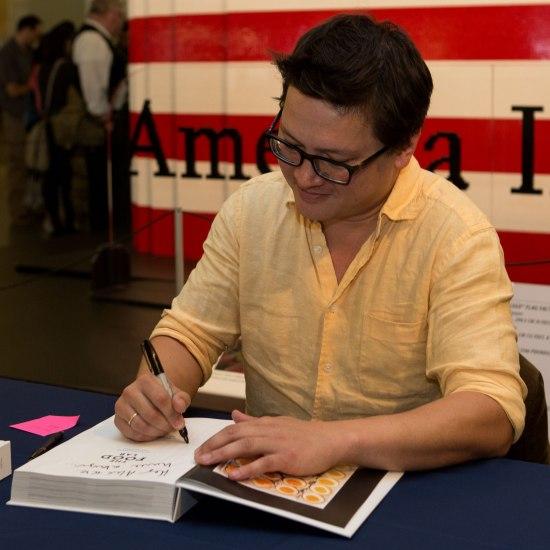 Man signing a book