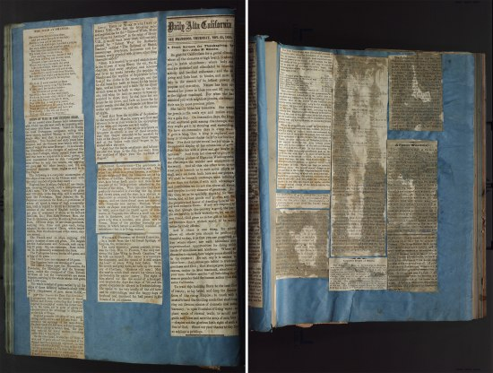 Two pages of the same object. Cutouts from newspapers, sometimes entire columns, are cut out and attached to a medium blue background. The paper is wrinkled in some places and looks like it has been affected by some sort of moisture. Some of the newspaper articles are stained and barely legible.