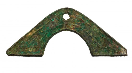 Handle-shaped metal object with hole punched in top. Brown, green, and turquoise.