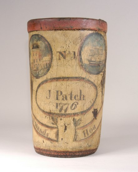"A bucket made out of cracked leather and painted yellow, with oval illustrations of houses and ships and words such as ""No. 1"" and ""J. Patch 1776"""