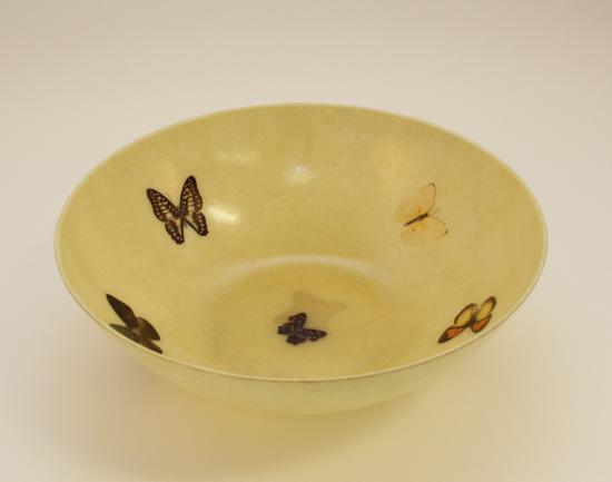 Wide-mouthed yellow bowl with butterfly