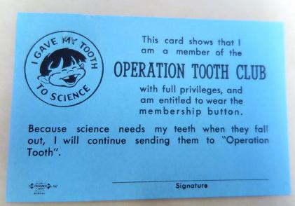 Small blue card signifying membership in Operation Tooth Club