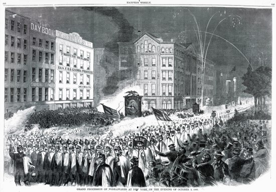 A black and white illustration of a group of men in capes and black hats parading down a city street carrying lanterns on poles. There are tall multi-floor buildings, spectators, and some fireworks.