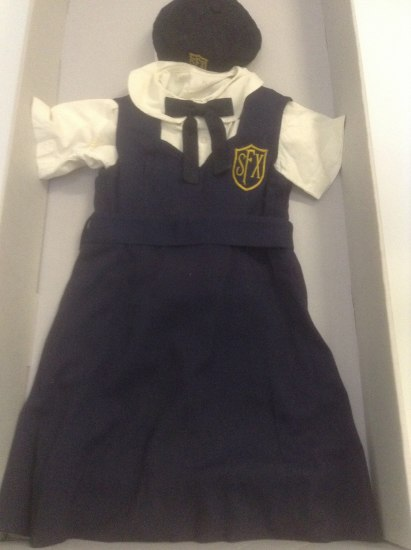 """Photo of a navy and white school uniform with letters """"SFX"""" on it"""