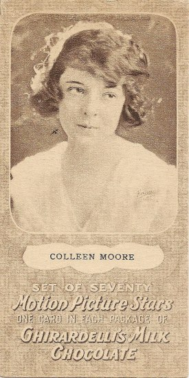 A rectangular, toffee-colored card with a textured background. A photo of a young woman take up most of the space. She has cropped brown hair and wears a white top. Below is some text.
