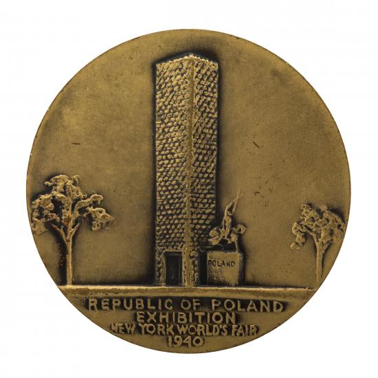 Photo of coin with tall tower and tree