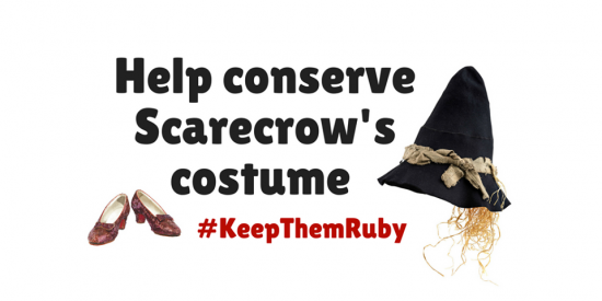 "Graphic with text ""Help conserve Scarecrow's costume"" and small image of Ruby Slippers and Scarecrow's black pointed hat"
