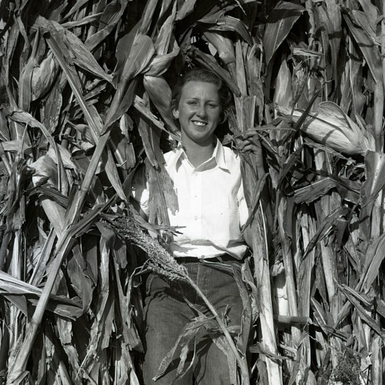 Black and white photo of a woman in corn