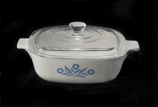 A white CorningWare dish with blue cornflowers on the side.