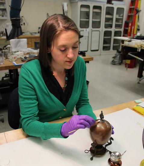 Conservator Diana Galante at work in the Objects Lab