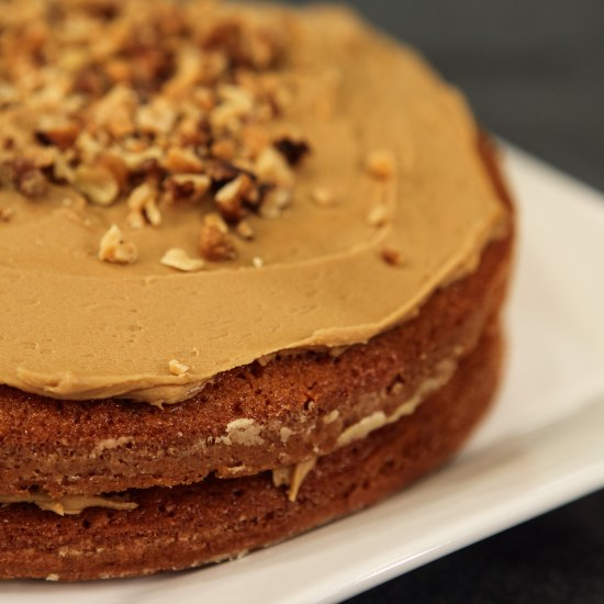 Frosted cake with nuts on top