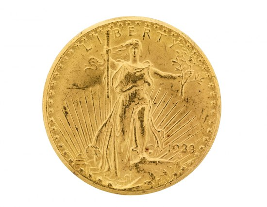 Photo of gold coin with figure of a woman in flowing gown/toga, long hair flying off her shoulder, holding a staff.