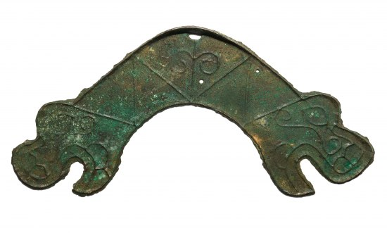 Handle-shaped metal object with a face-like image on one side, open-mouthed and eye.
