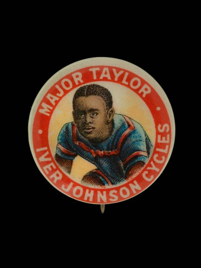 Photo of a small pin with an illustration of cyclist Marshall Major Taylor, wearing a red and blue cycling uniform