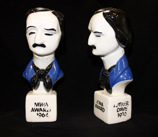 "Ceramic or glass-looking awards that are designed to look like Edgar Allen Poe (via hair with sidepart, mustache, etc). Though it has worn away with age, one says ""MWA Award 1964"" on its white base."