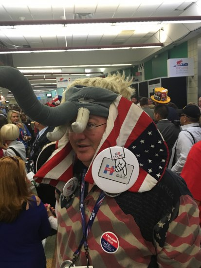 Man wearing elephant hat with flag-themed ears