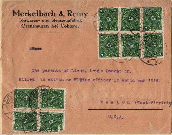 Tan envelope with eight green postal stamps and German text