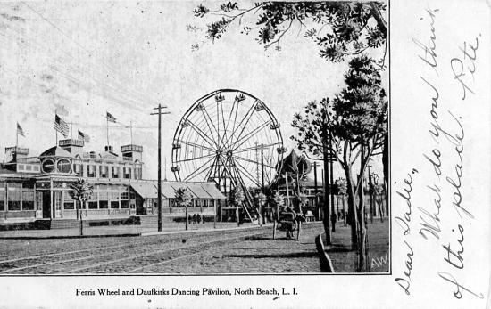 Black-and-white photo with ferris wheel and buildings