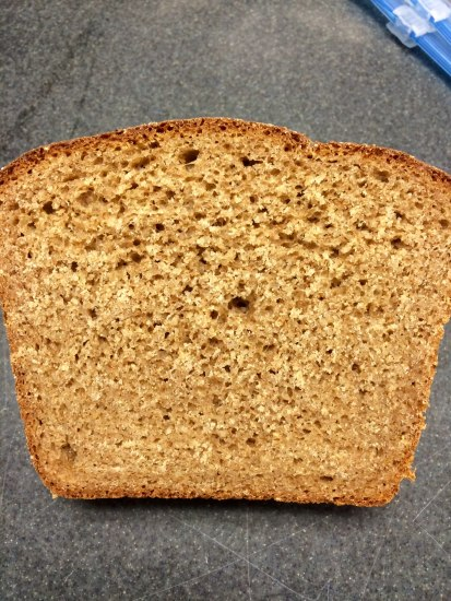 A picture of a piece of light brown bread taken from directly over it. The bread is rougher in texture.