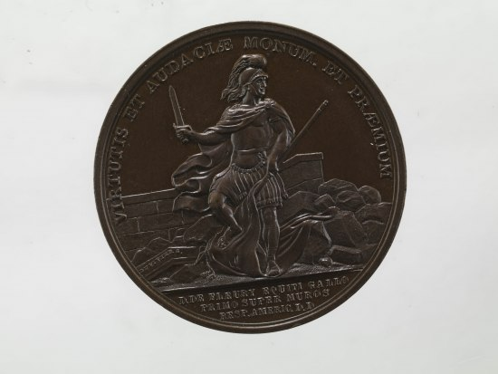 Coin with image of a man holding a sword