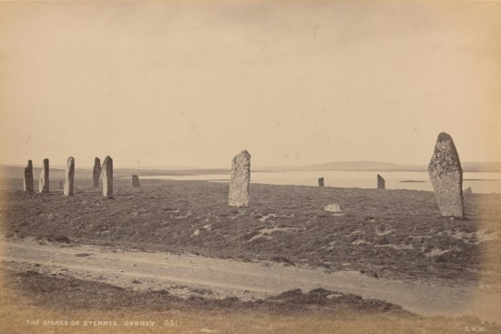 large flat stones standing upright in the ground in what once was likely a large ring formation