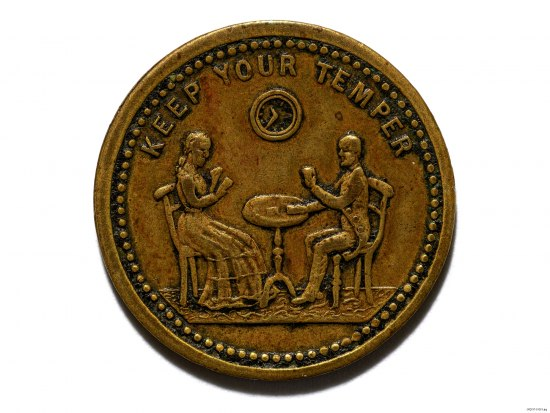 """Gold-colored metal coin. Two figures sit at a table, one man and one woman, playing cards. Text: """"Keep your temper."""" Clock on wall behind them."""