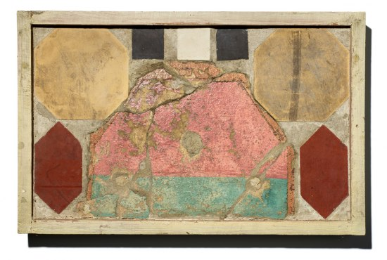 Rectangular piece of tile with geometric shapes in various colors: black, white, red, yellow, and pink