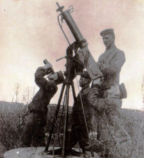 Four soldiers watching the sky, with gun pointed in the air