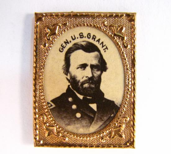 Campaign badge with a gold-colored frame and photo of Grant