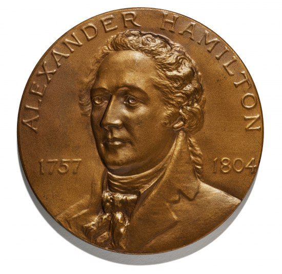 Bronze-colored medal, circular. Portrait of Alexander Hamilton wearing high collar. Dates 1757 and 1804. His hair is in a ponytail.