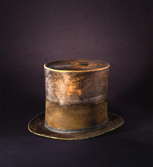 Wide-brimmed, tall top hat with band around it