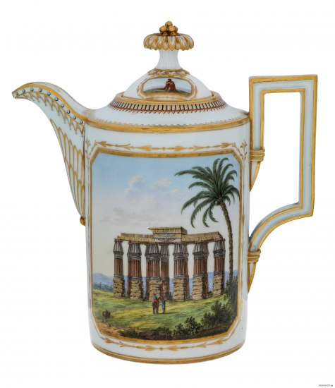A tea pot or kettle made out of white glass with gold decoration and a color illustration of an old columned structure in a warm clime somewhere
