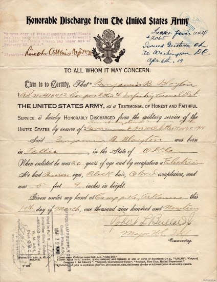 "Form with eagle on top. On the top, it says ""Honorable Discharge from the United States Army."" The form has been filled out in neat cursive writing and stamped in two places."