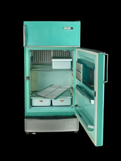Color photo of turquoise fridge on black background. Door open to reveal interior shelves and drawers.