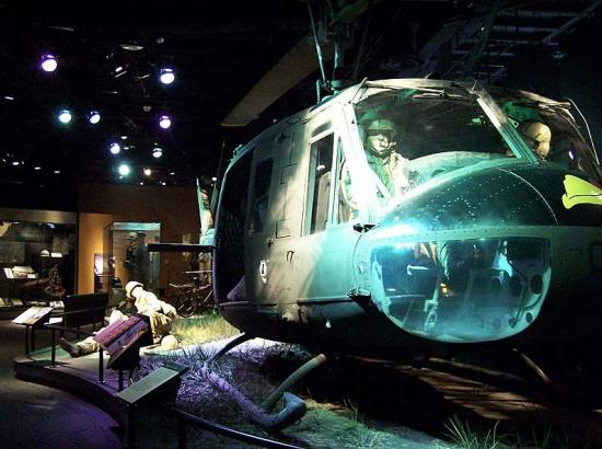 Huey Helicopter (nose portion facing camera) in exhibit with panels