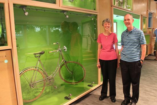 Mittie Wiley's great-grandchildren, Hulit and Bill, next to the bicycle on display in Object Project