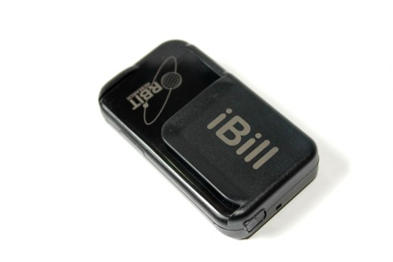 "A small, black, rectangular plastic device that looks like it could rest in the palm of a hand. In light grey text, it says ""iBill"" and ""RBIT"" on the top."