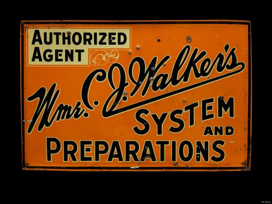 "Photograph of sign for an authorized agent of the Madam C. J. Walker Company. Themetal sign is orange with black text. The text reads ""Auhorized Agent...Mmr. C. J. Walker...System and Preparations."""