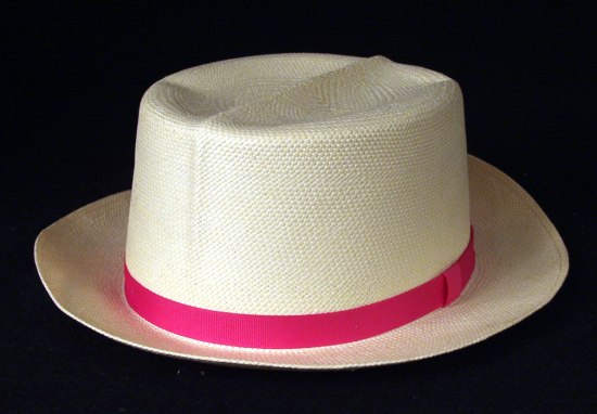 A straw hat with a magenta ribbon running above the brim