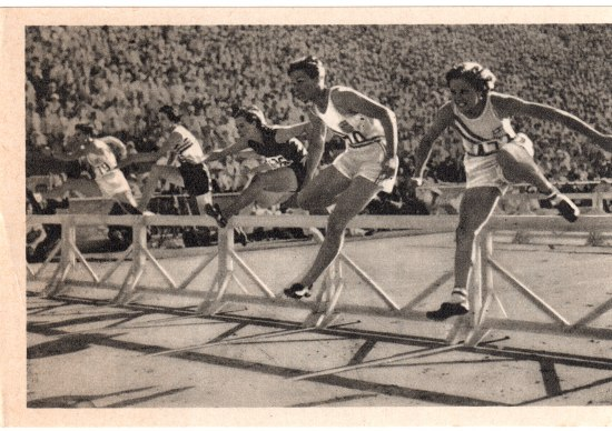 A black and white photograph of runners jumping over hurdles