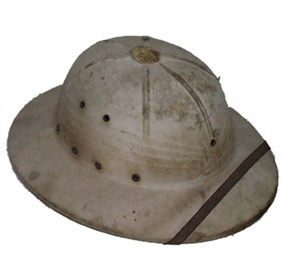 A type of helmet typically attributed to explorers of the jungles in popular culture. It is cream colored (though very dirty) with a flat brim extending several inches. There is what looks to be a leather strip across the brim of the hat.