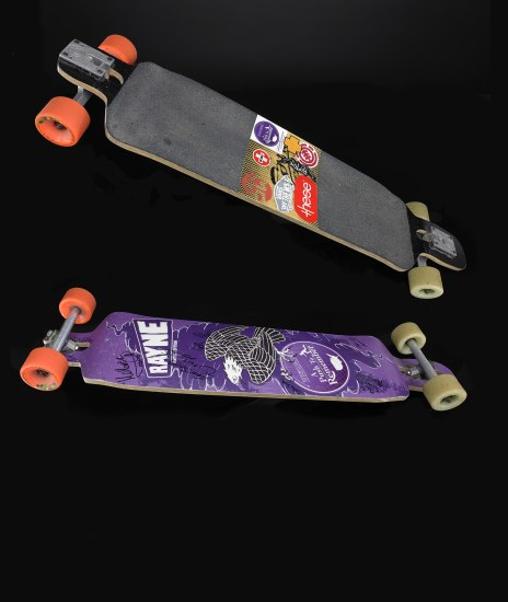 Two views of either side of a skateboard; the top is purple with graphic designs on it. The bottom is black.