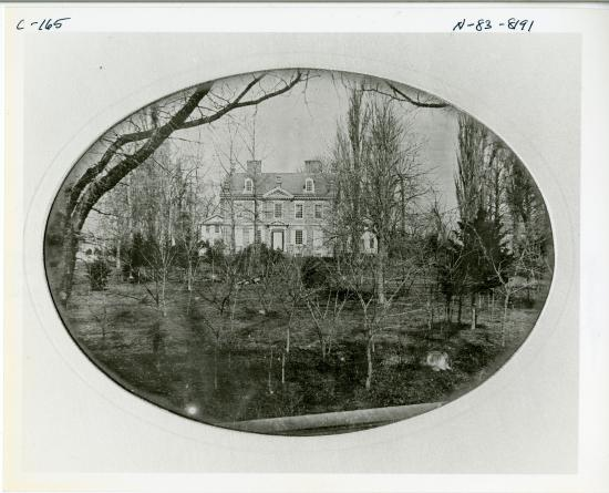 Black and white photo of building, framed in circle