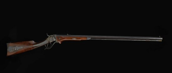 Photo of long rifle with brown wood