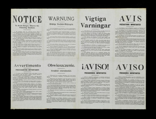 A 1910 safety sign where various warnings are reprinted in eight different languages, arranged side by side on a single large sheet.