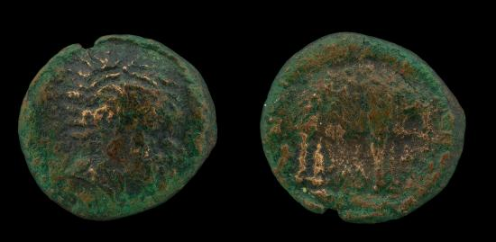 Side-by-side photos of the front and back of a coin. Slightly blue. Raised, gold-colored pattern.
