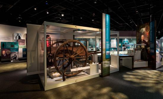Photograph of the exhibition's Merchant Era section with Red River Cart