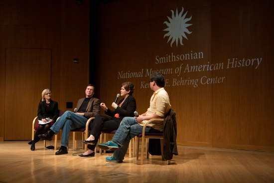 Panel of four people on stage