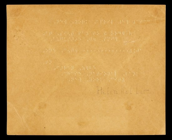 A gold piece of paper with raised dots on it and the signature of Helen Keller printed on the bottom right.