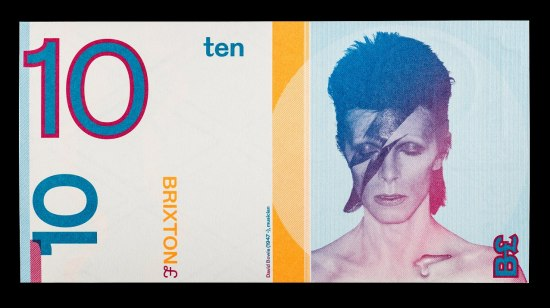 """A rectangular piece of currency with David Bowie during his Ziggy Stardust phase on the right half and several """"10""""s and other markings on the rest of the bill."""
